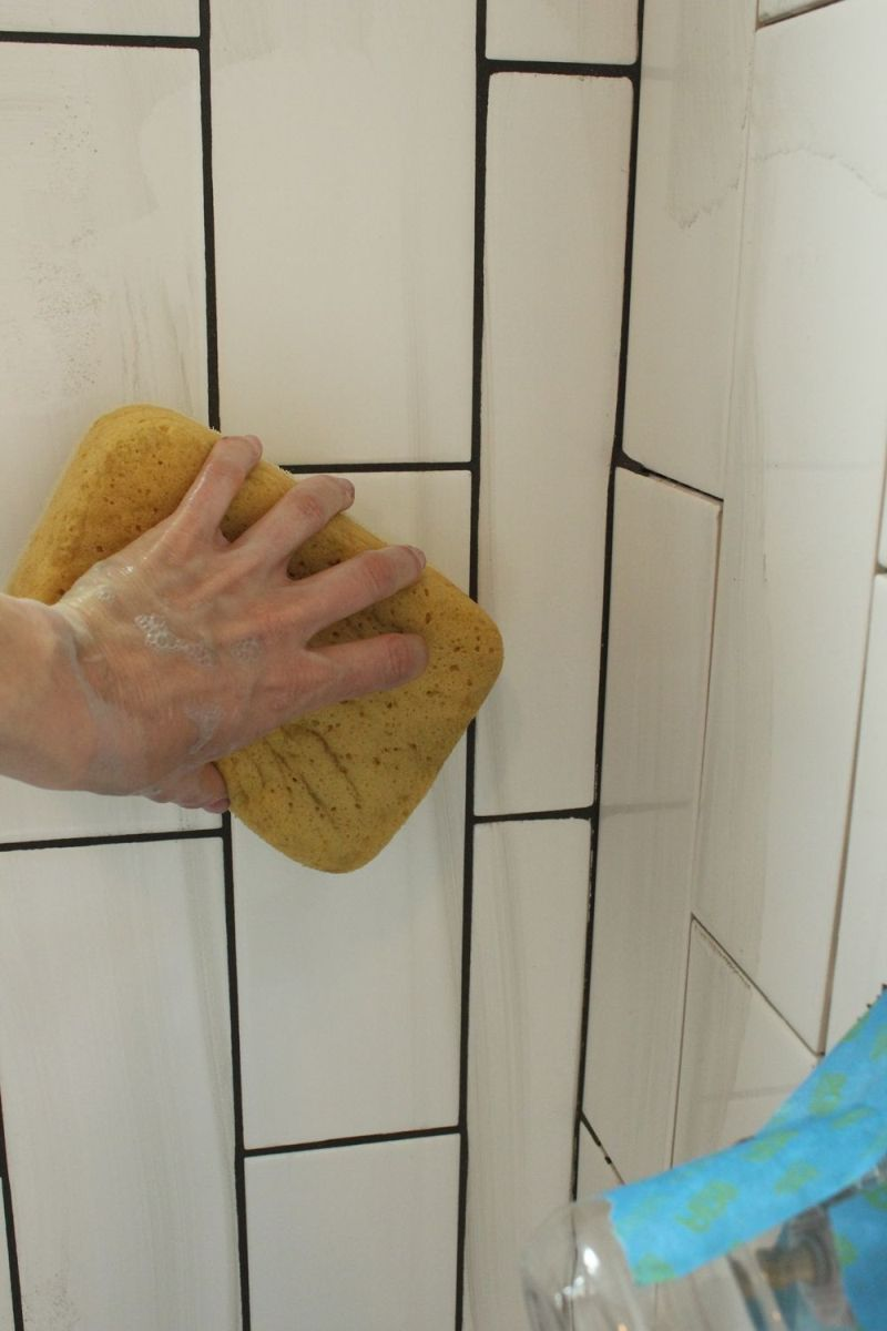 Sponge with water the tiles