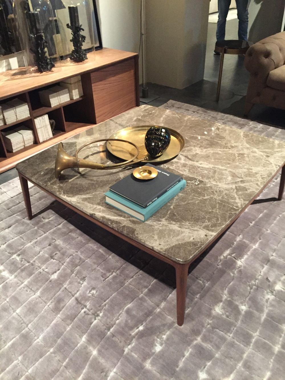 Square marble coffee table with a mid century base