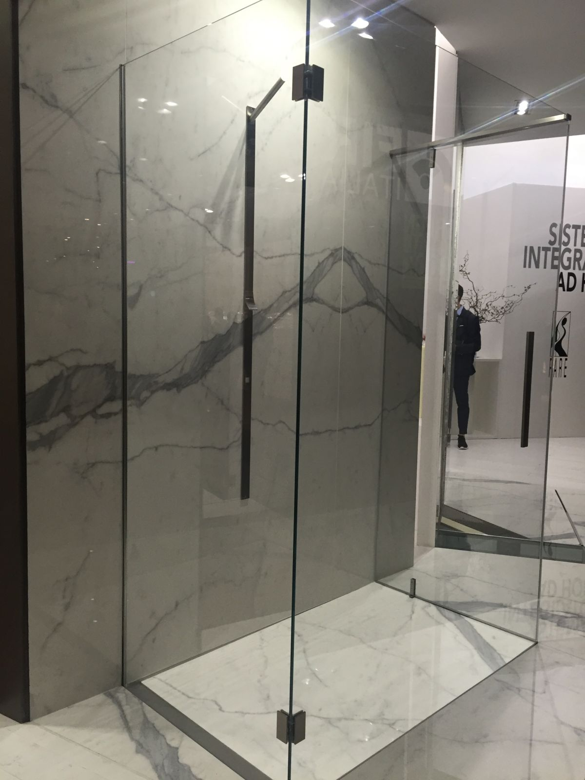 Walk in shower with marble tiles and glass