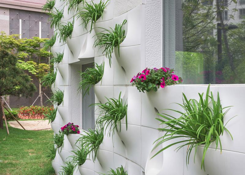 Wall facade built in flower pots