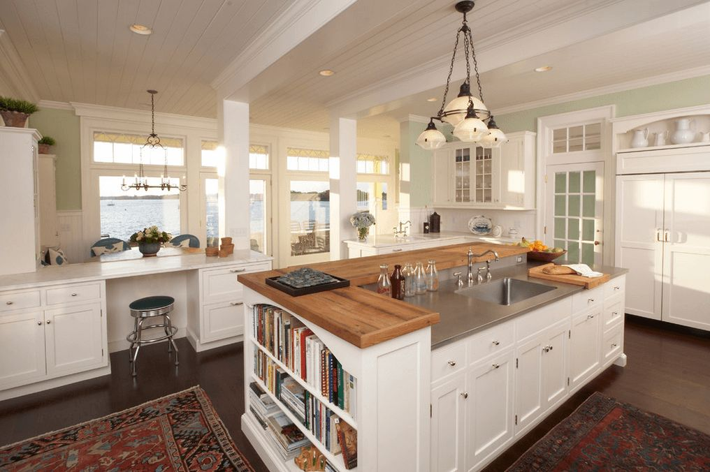 White kitchen island with a butcher counter top