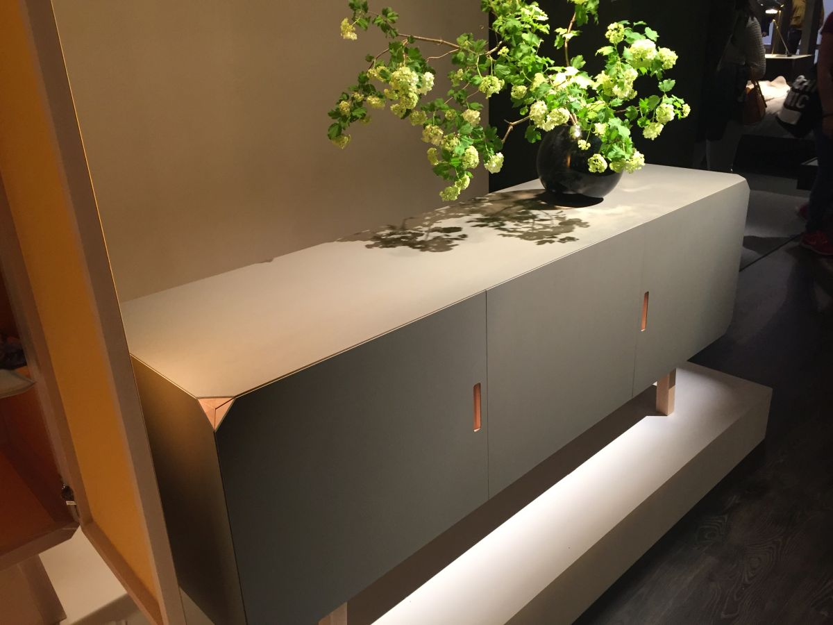 sideboard decorated with a green plant