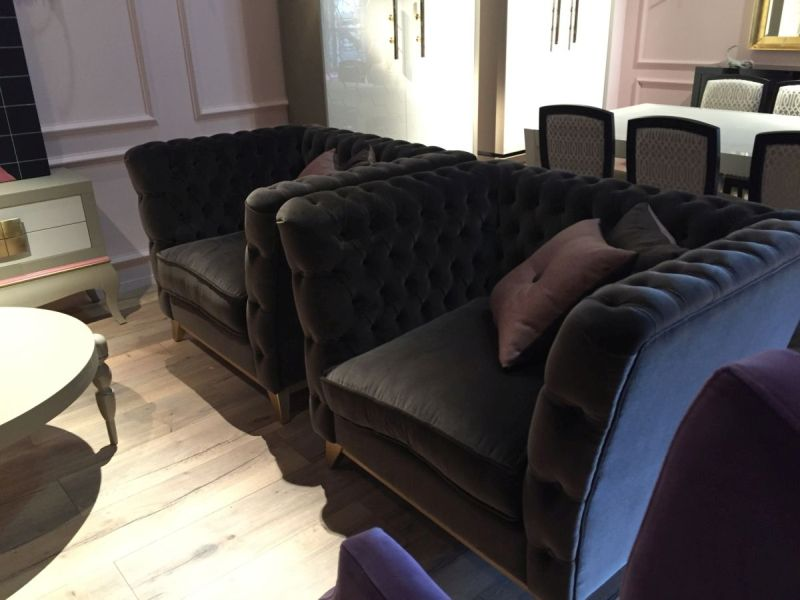 sumptuous tufted armchairs