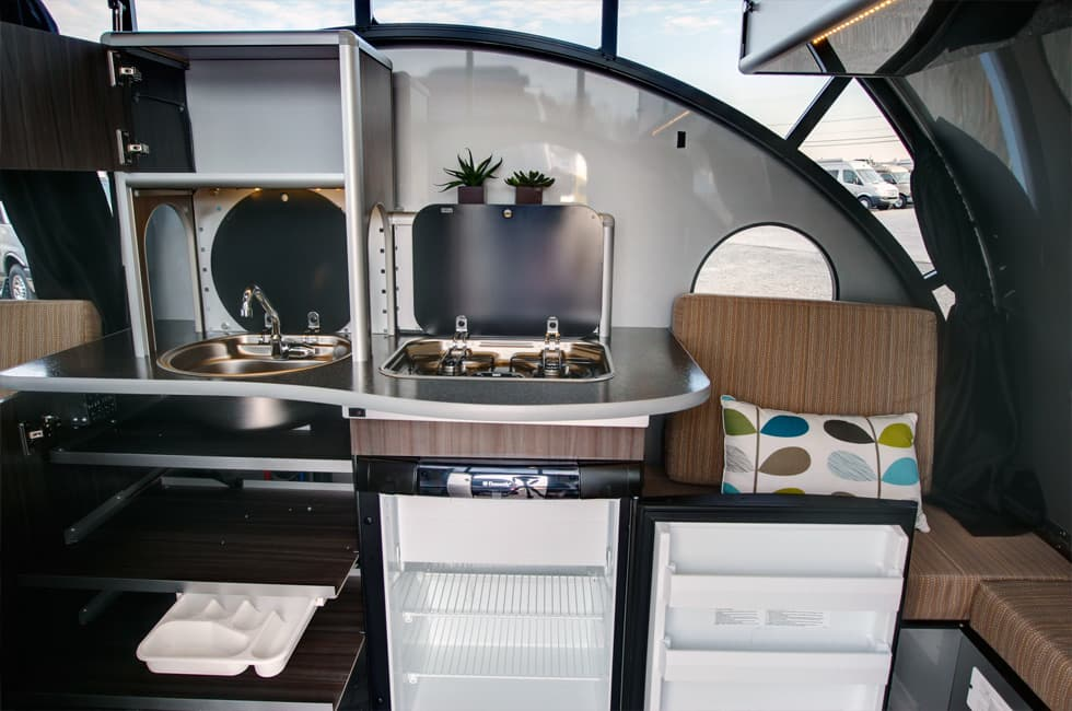 teardrop trailer transforms into a large family camper kitchen