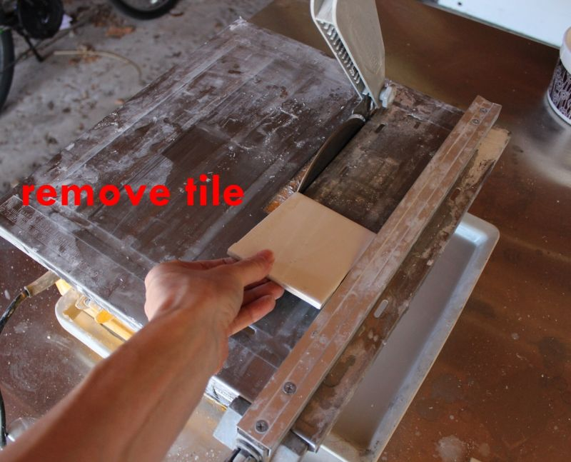 tile saw turned off and blade completely stopped