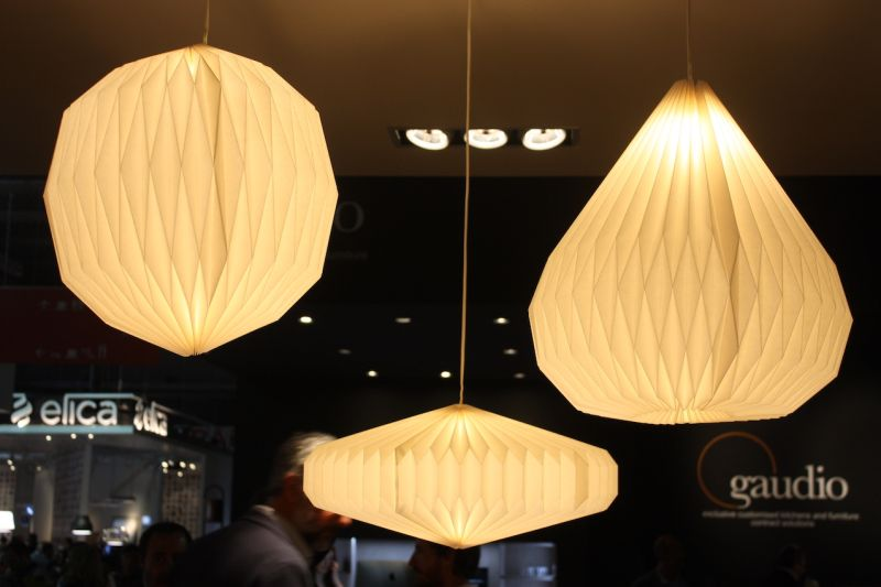 A closer look reveals the accordion folds of these pendant fixtures.