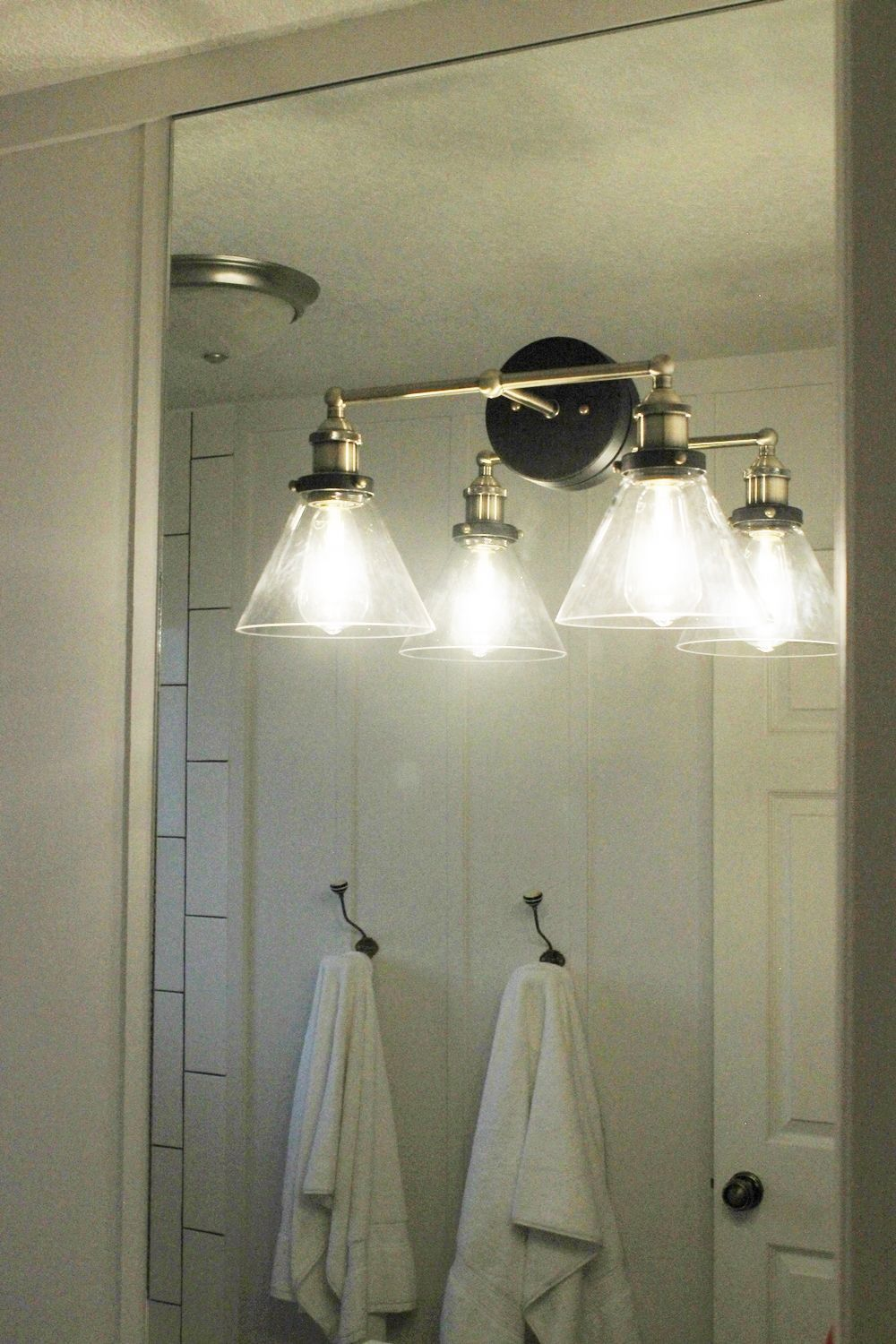 Vanity Lights Installed On Mirror : How to Mount a Light On Top of a Mirror Bathroom Vanity