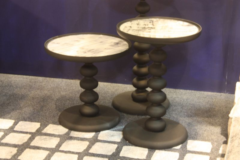 This trio of lovely tables by Airnova is versatile and attractive. The stacked ball pedestal is fun and they work well grouped together or singly, .