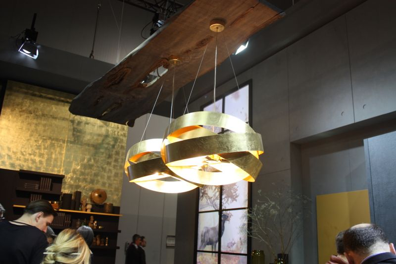 The gleaming metal of the fixture is offset by the live edge base an interesting