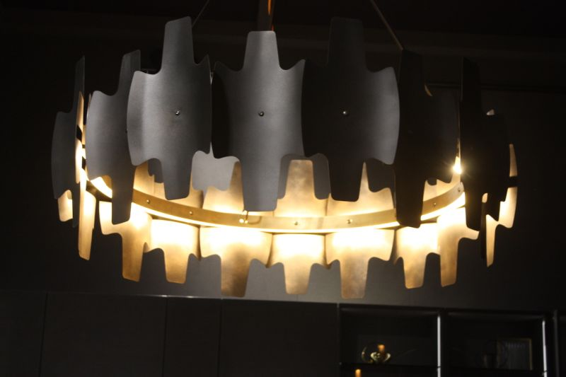 The dark and jagged kitchen chandelier shown by Ar-Tre is a dramatic choice for kitchen lighting. The interior's metallic finish only enhances the dark exterior and unusual shape.
