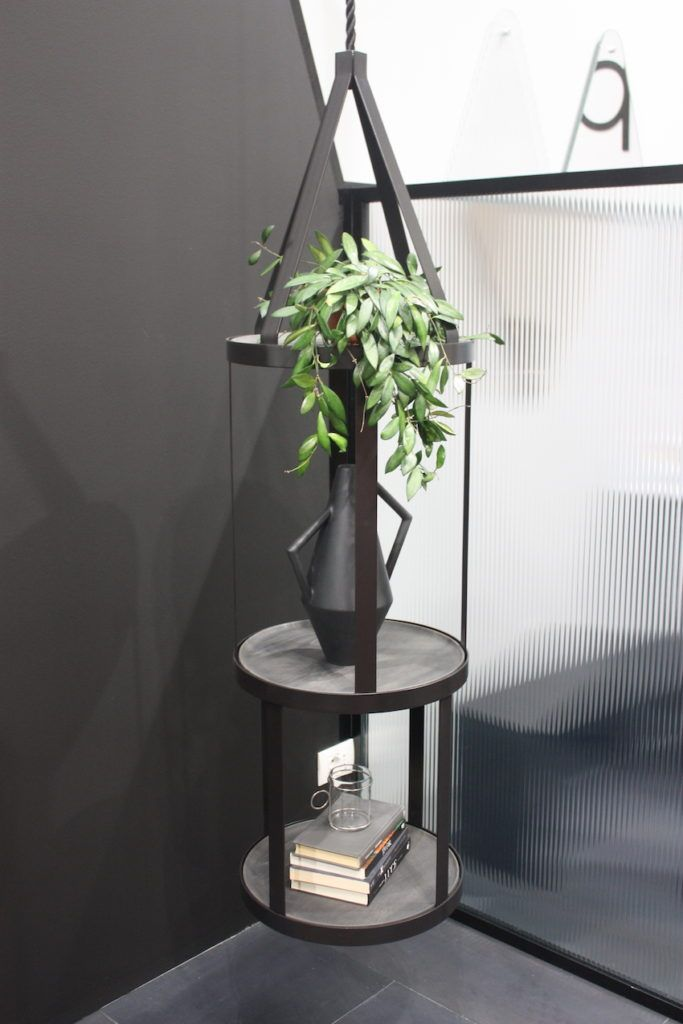 Atypico classifies this as a plant stand, but it also makes a grand occasional table. Suspended from the ceiling, it offers a place to stash your books or magazines, as well as display a few objects, like this Kora vase.