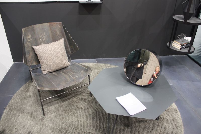 Atipico's hexagon-shaped table has an industrial vibe thanks to the gray color. The hairpin style legs keep it modern and tabletop's shape is an unexpected feature.