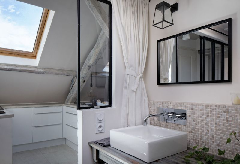 Attic apartment in France bathroom mirror