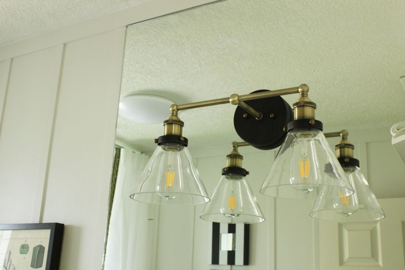 Bathroom lighting on mirror from brass