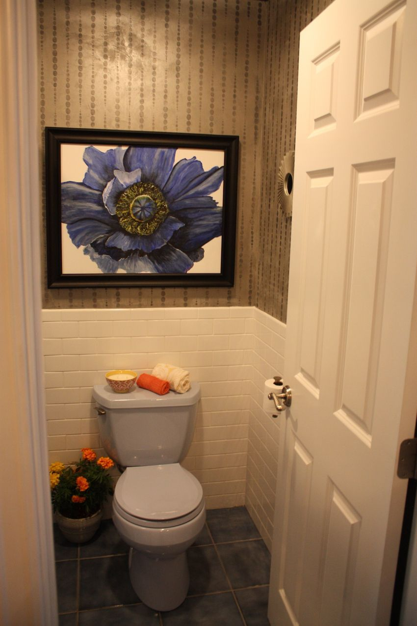Bathroon toilet room with wall art above