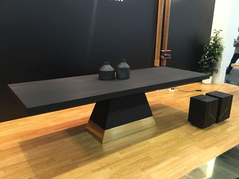 Black dining table from wood with a touch of gold