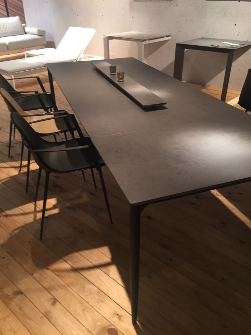 Black dining table with a rectangular shape