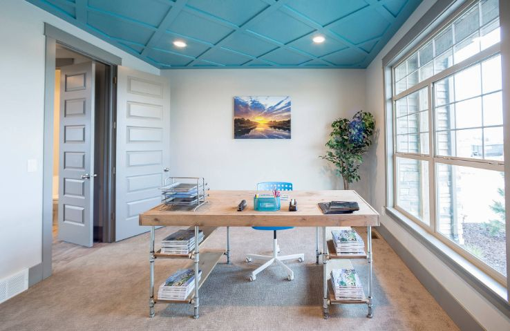 Blue ceiling office design with pipes legs for desk