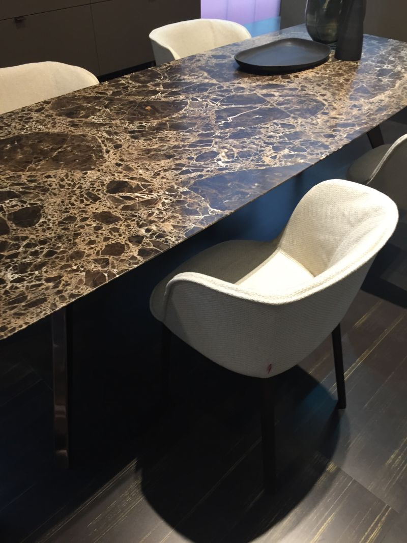 Brown marble table with white chairs