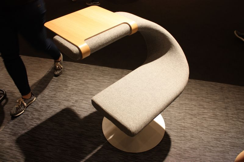 The Innovation C upholstered swivel chair by Bla Station is lots of fun because you can sit on it in any direction. Straddle the seat, sit facing the table, or pull off the table attachment and use the arm as a backrest.