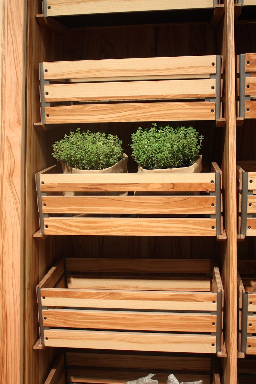 The crate-style wooden shelving allows you to pull out each unit and take the entire box, or just the one or two items that you need. the crates would also let you store loose time such as potatoes or unions, as well as dishware, packaged goods, and kitchen utensils.