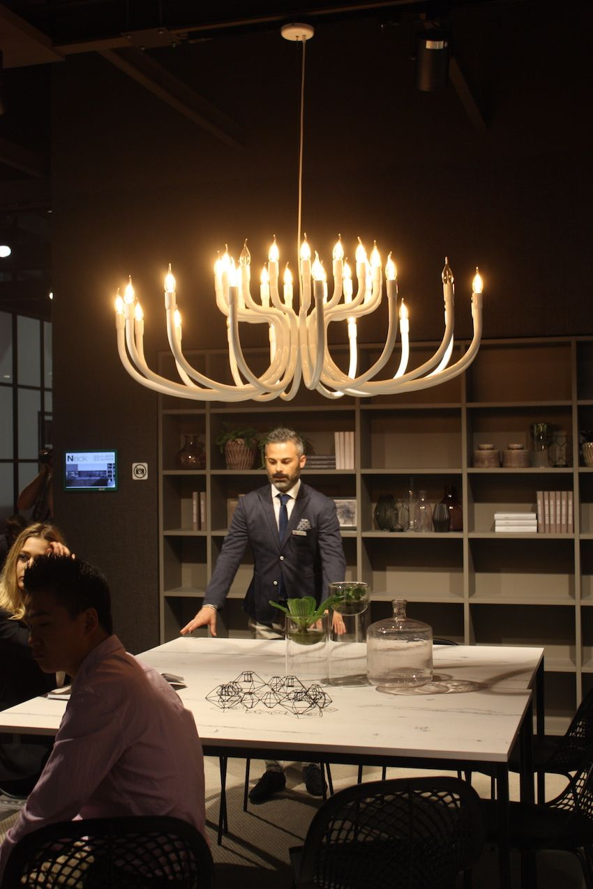 Cucine Lube's large chandelier has a modern flame look that evokes a bit of a rustic feel. Used over a dining table in this setting, it could also serve as dramatic kitchen island lighting.