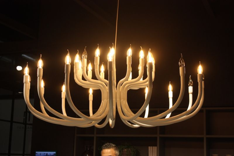 The many smooth, curved tubes remind us of the animal antler-style lighting fixtures popular for woodsy hide-aways.