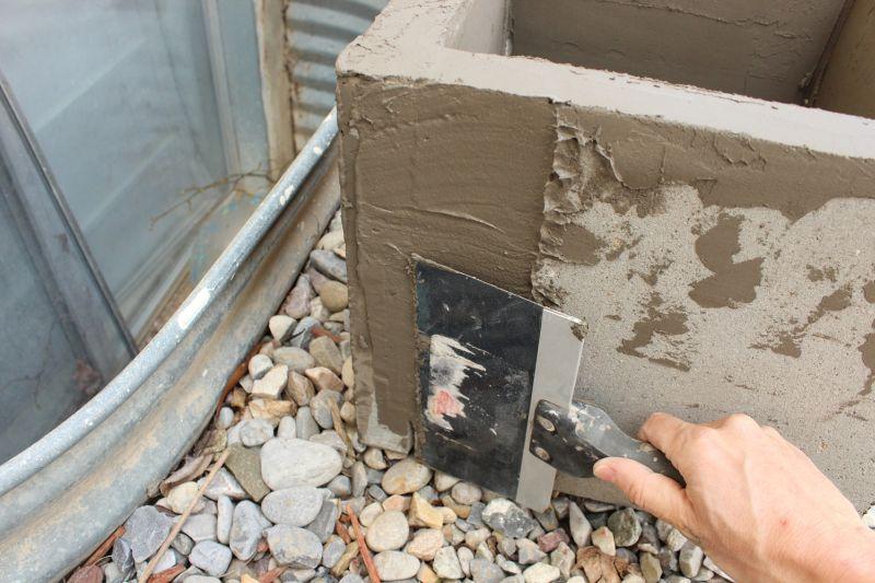 DIY Concrete Planters-add more mix