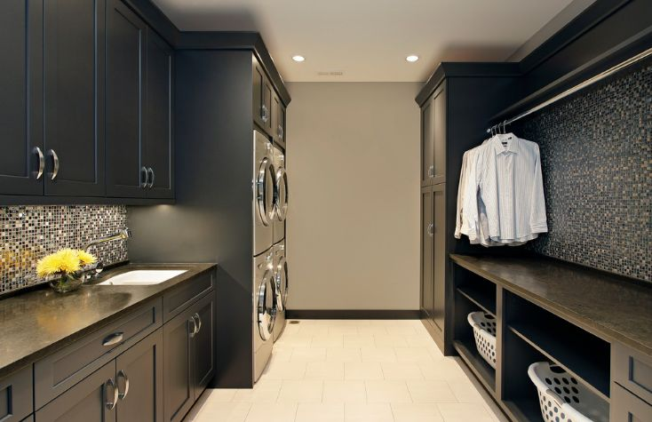 Dark laundry room design with mosaic backsplash
