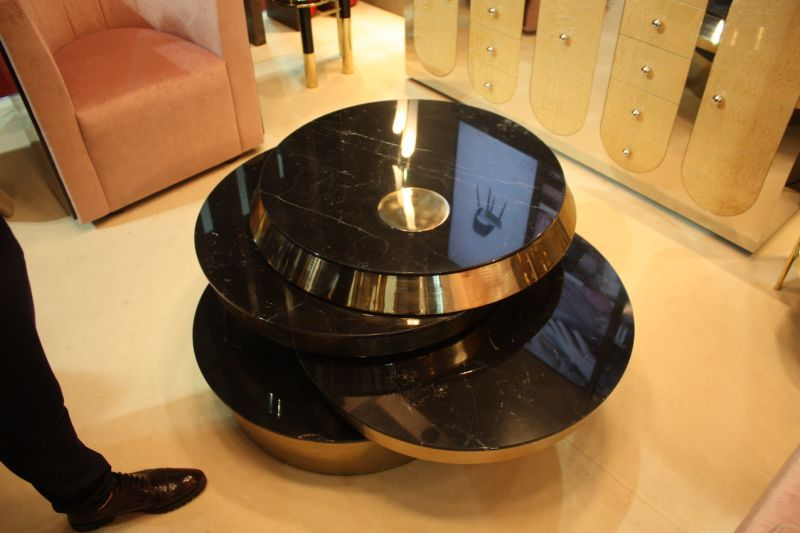 New Coffee Table Designs Offer Style And Functionality - Geometric round coffee table