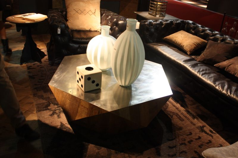 What a perfect coffee table for a game-loving family! Dialma Brown's casual wooden table is lots of fun.