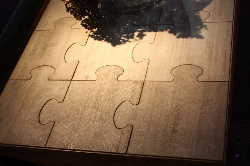 Even the sides of the wooden coffee table are puzzle-like...they seem to be missing a piece!
