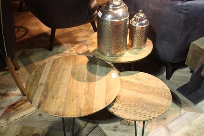 Dialma Brown's round rough wood-topped side tables, which come in trio of heights, are perfect for mixing and would work well in a casual decor style.