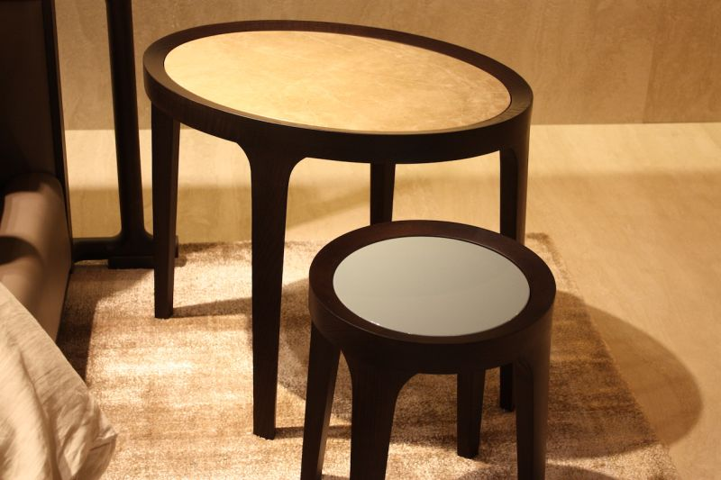 The DIDA side table from Flexform can be purchased as a round, square or rectangle. A marble top -- available in different colors -- sits in a slid wood base, which is also available in different types.