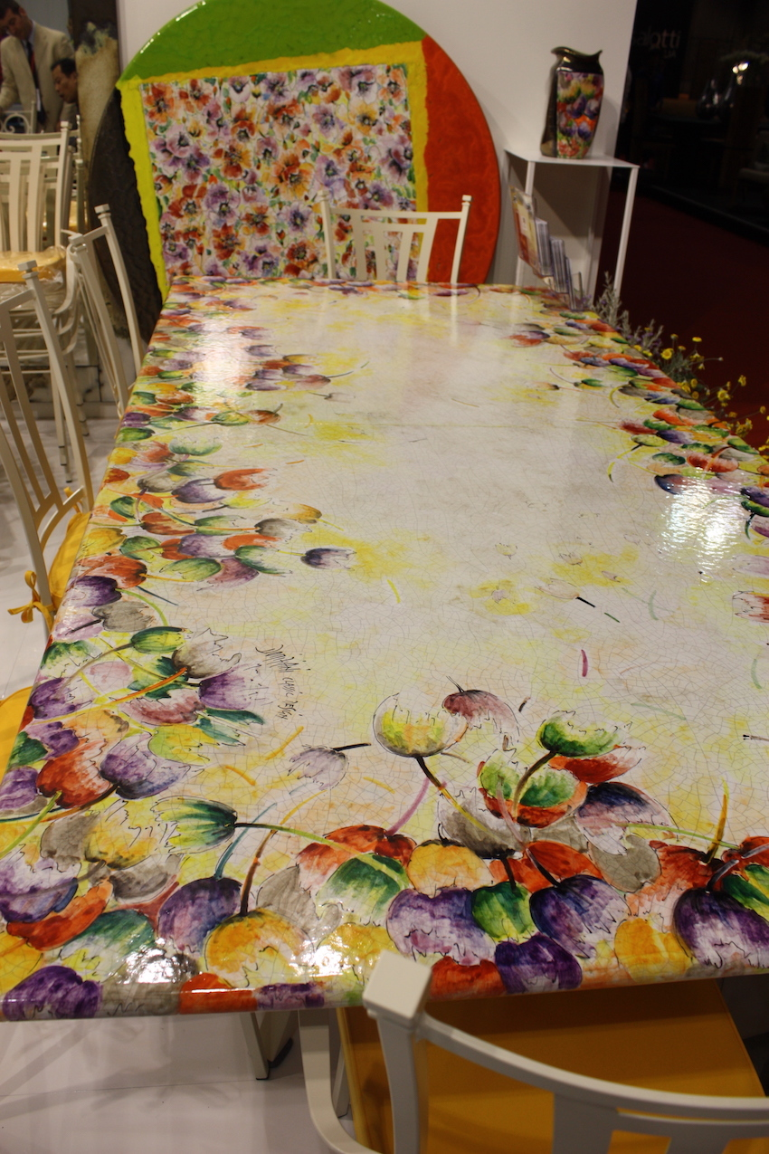 Among the floral designs available for their outdoor dining tables is this happy motif, which can cover the whole table or just the border.