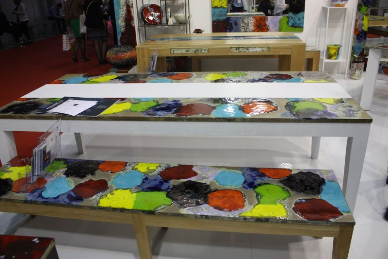 The colorfully patterned work can be made into outdoor tables, benches, chairs and accessories, as well as indoor pieces such as washbasins.