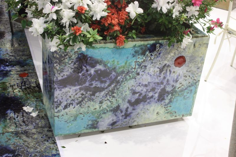 Even if your outdoor living space is already furnished, you can include colorful accessories like this planter from Domiziana. The modern, freeform pattern is perfect for just about any style of outdoor decor.