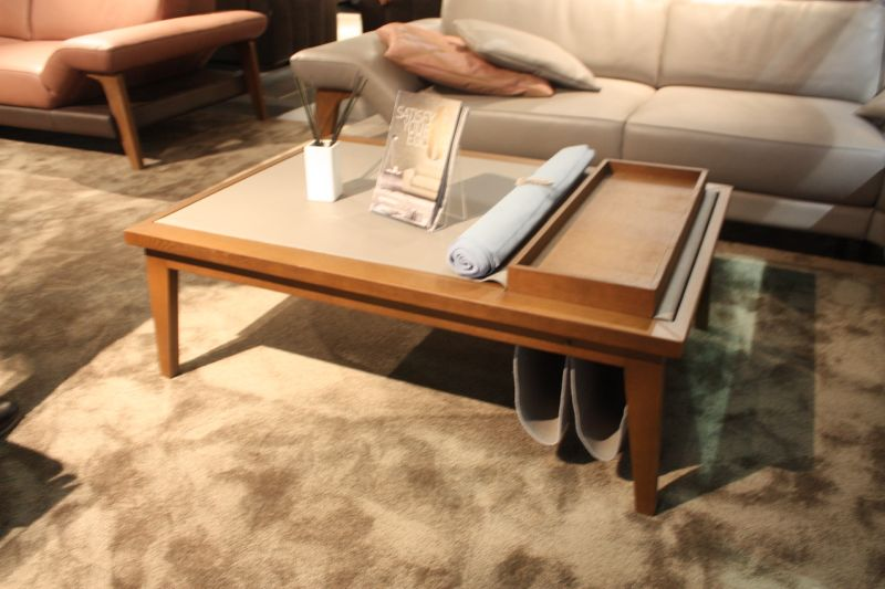 This coffee table from Ego Italiano has just as much function as it does form! The Bergen is a rectangular oak coffee table with a removable tray and a removable leather cover, that extends to create the sling holders for magazines and newspapers.