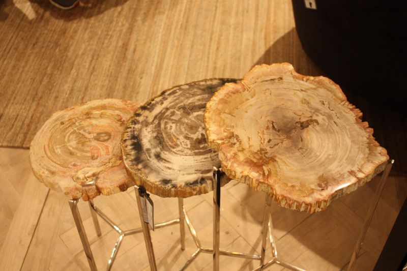 These unique set of side tables from Eichholz is made from petrified wood sitting atop a stainless steel base. Each piece of petrified wood is one-of-a-kind and so is each table. The Moylan table comes in different heights, making grouping easy.