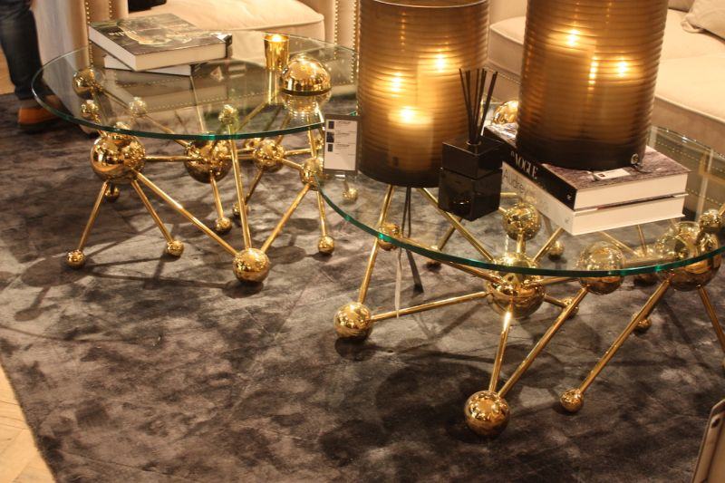 A luxurious tangle of balls and bars, the Galileo coffee table by Eichholz is made of a glass top and gold-finished base. The same style is also available as a console table and a desk.
