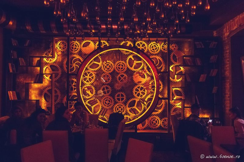 Enigma Cafe and Bar giant clock covers entire wall