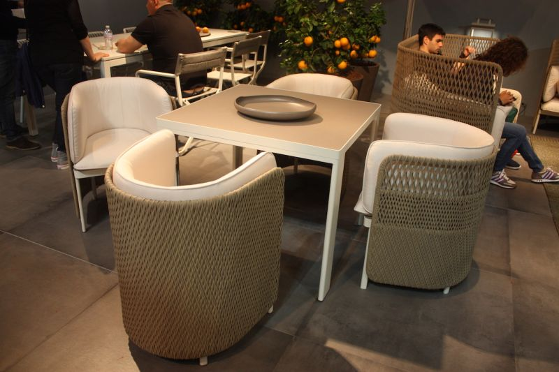 Barrel-shaped armchairs from Ethimo Outdoor Decor look so comfy we'd never want to leave the table.