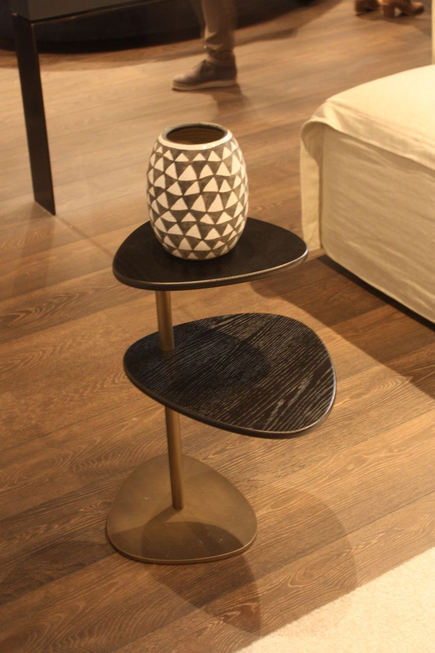 The top to levels of this slight but very interesting table from Euromobil almost seem to float when the base blends in with the flooring. It's perfect for spaces large and small.