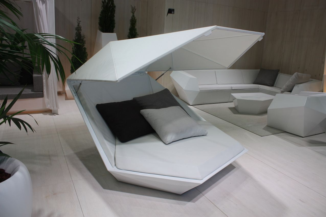 The FAZ Daybed by Ramón Esteve -- like the other pieces in the FAZ collection -- has an angular, mineral-like shape. The modern daybed is great as a poolside retreat from the sun.