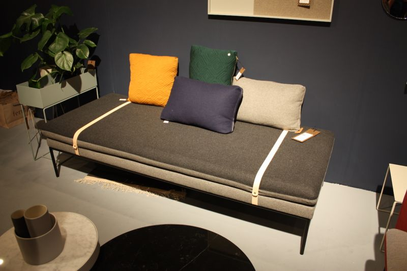 "The interesting straps on Ferm's ""Turn"" daybed aren't the only detail we fell for. The top cushion of the daybed -- and the matching sofa -- is made with two colors so you can change up your decor with minimal effort."