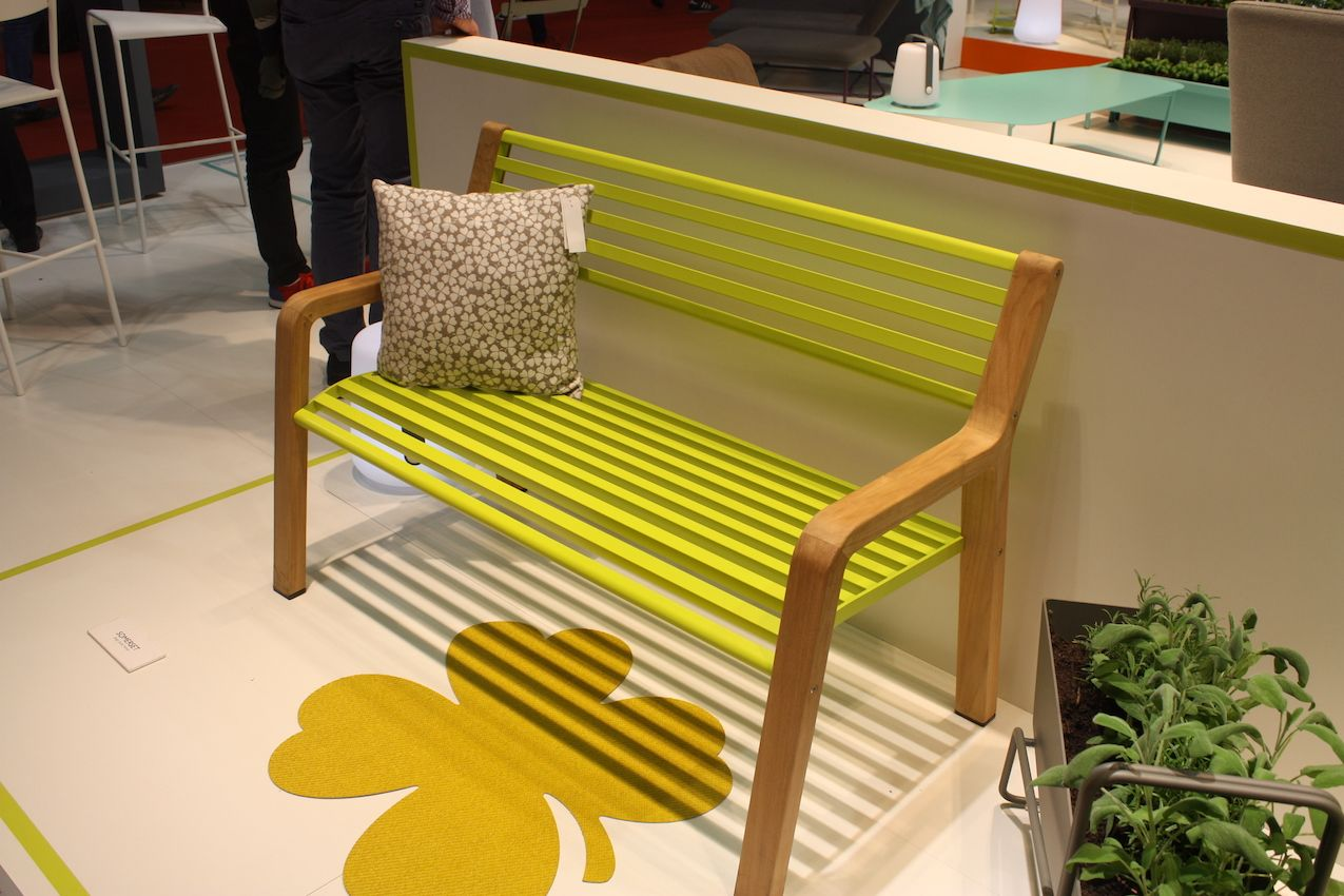 Fermob's new bench has a wooden frame with thinner slats for seating and the back. While it;'s reminiscent of a Parisian park bench, those details -- and the vibrant color -- give it a more modern look.