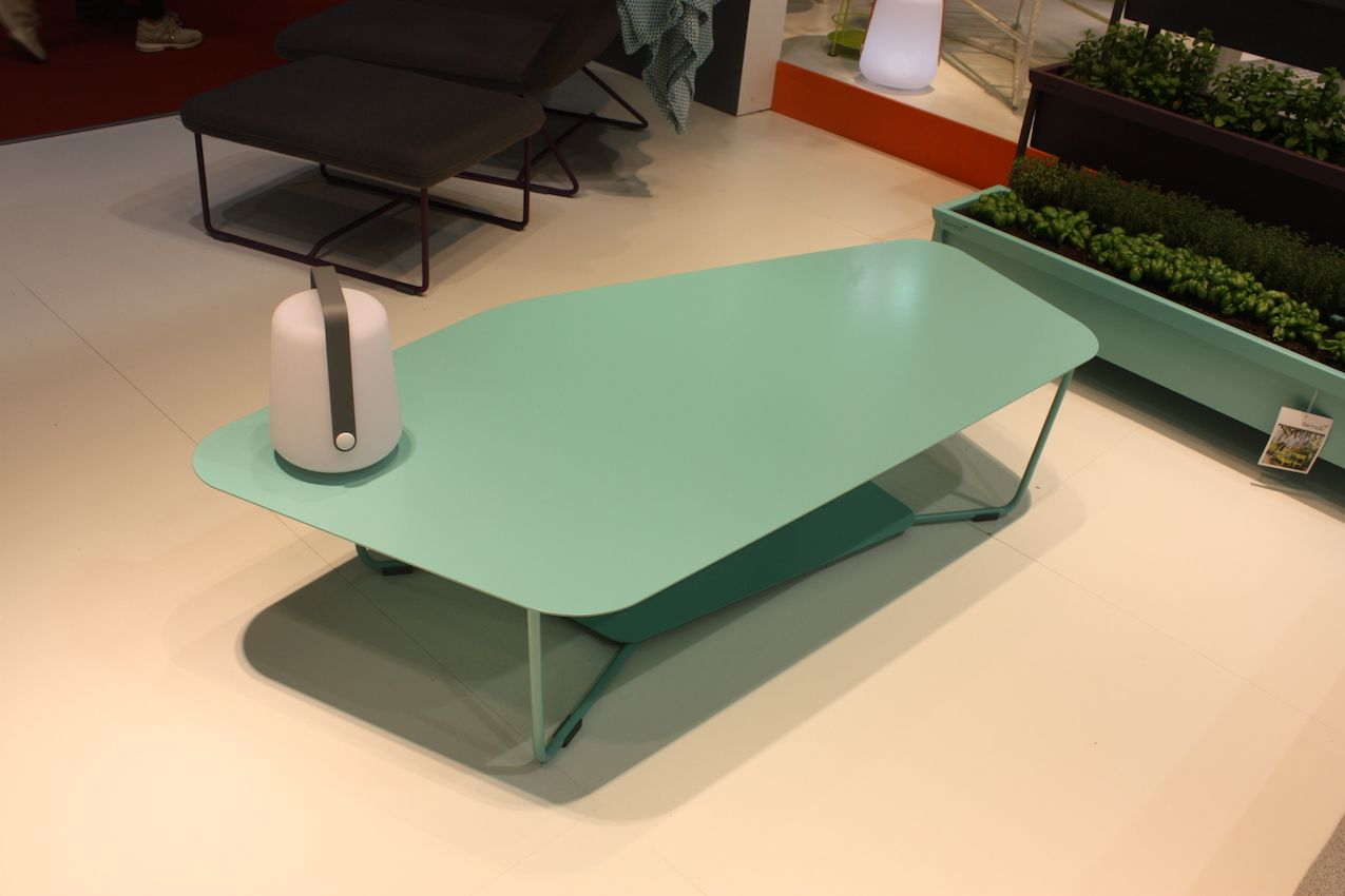 A pastel trapezoid is a modern option for outdoor table. Fermob's pieces are fresh and colorful.