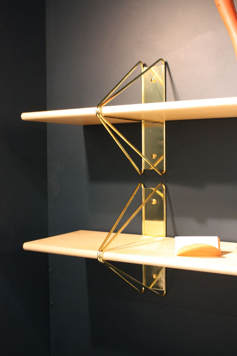 Floating shelves with gold brackets