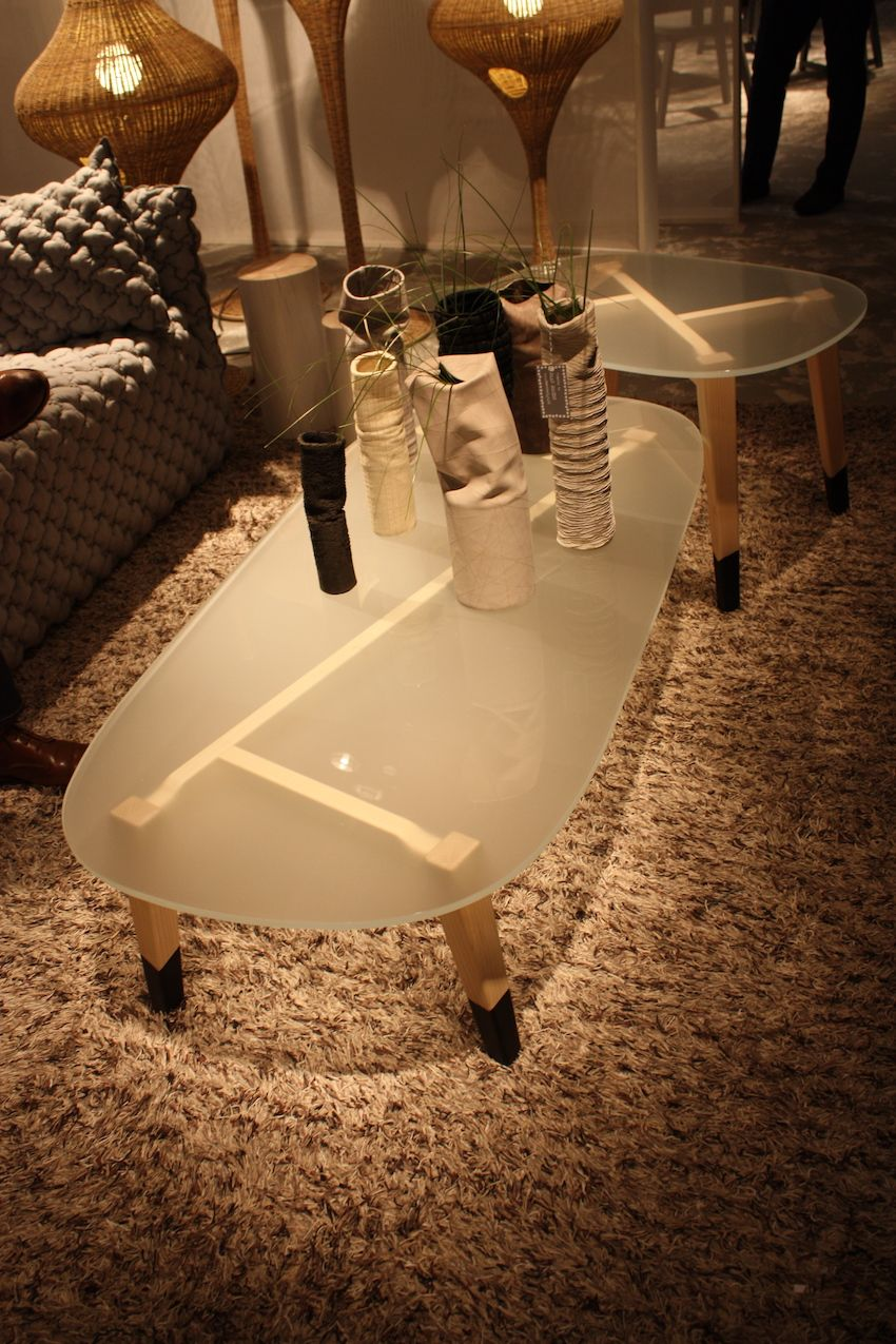 Frosted glass and lacqueredlegs make for a fun and versatile coffee table from Gervasoni.