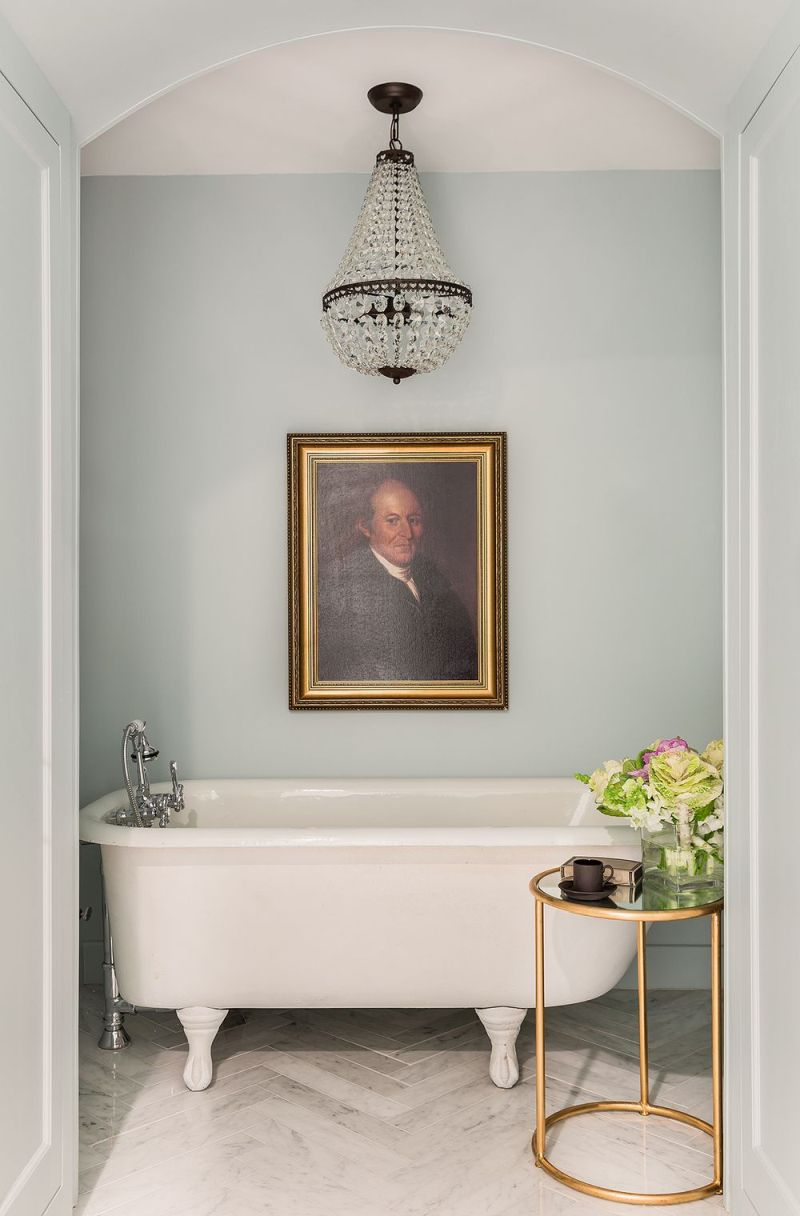 Gold frame wall art above the bathtub